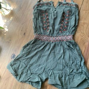 Boho vintage moss green romper with beaded detail.